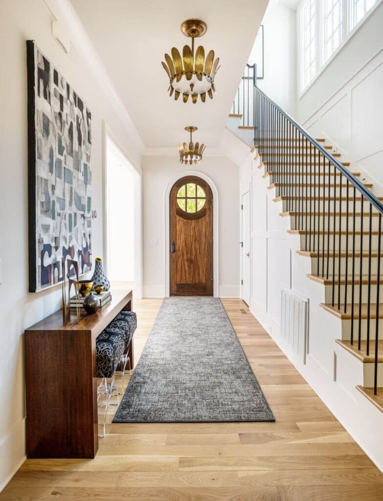Take these tips to heart when selecting pieces for your hallways and entryways.   Beth Haley Design